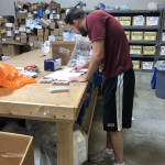 David Harrison'20 repairs donated medical equipment as a part of his summer internship with Project C.U.R.E.