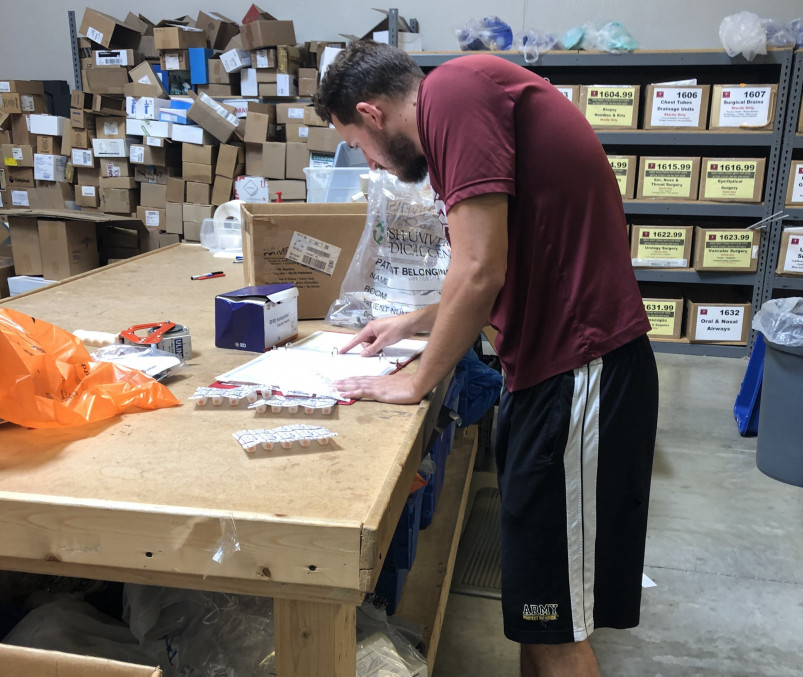 David Harrison'20 repairs donated medical equipment as a part of his summer internship with P...
