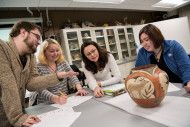 Professor Shannon Fie instructs a class studying pottery from ancient cultures.