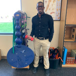 Meshach Roberts '19, holding a small weight in one of the physical therapy rooms at Athletico in Belvidere, IL at the start of his summer OPT training.