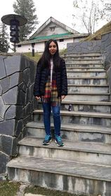 Raahima Talal's photo standing on the stair.