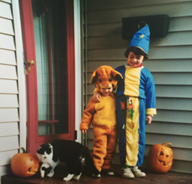 Halloween, 2002 with my sister and our cat, Pookie. I was a lion and she was a wizard!