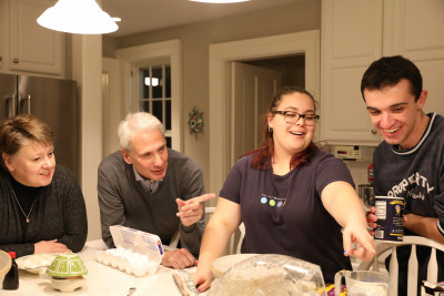 Students baking cookies with Scott and Melody Bierman.