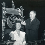 Beloit Relays queen being crowned by college president Croneis, 1945.