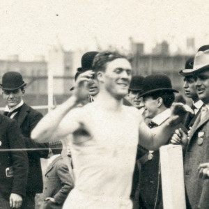 A close up on Edward Strong Merrill as he wins his race at the I.C.A.A. Track Meet in Chicago circa 1901.