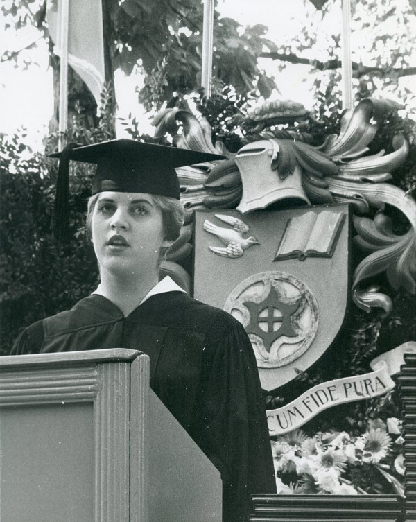 A student addresses their graduating class during commencement, circa 1963.