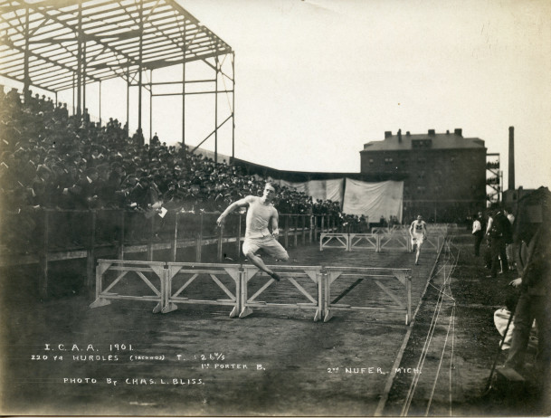 Lucius Chapin Porter in the midst of winning hurdles at the I.C.A.A. Track meet in Chicago circa ...