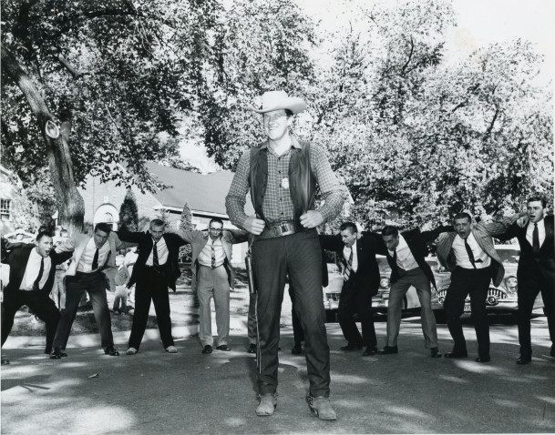James Arness surrounded by Beta Theta Pi's.
