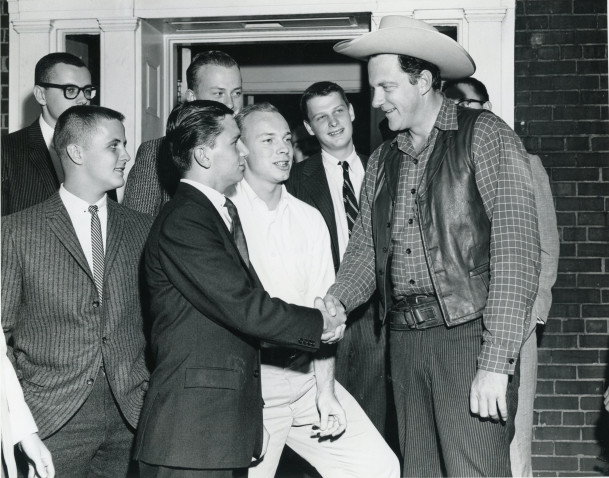 James Arness shaking hands with a Beta Theta Pi.