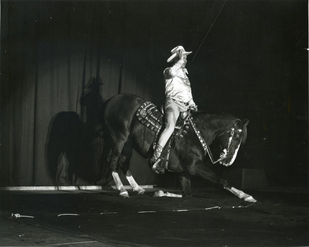 Gene Autry and his horse, Champion, perform inside the Field House.