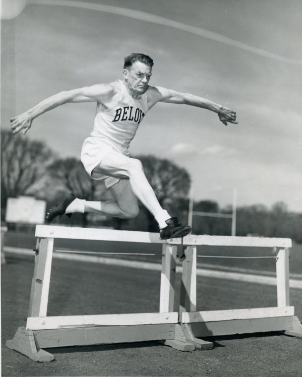 Lucius Porter running hurdles in his early 70s circa 1953