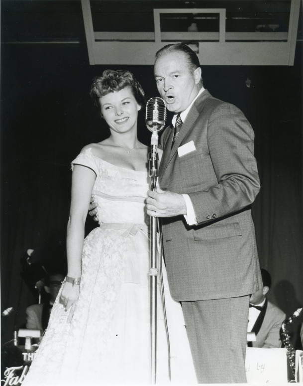Bob Hope and an unidentified woman inside the fieldhouse.