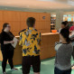 International students learn the rules for a race-against-time scavenger hunty in the library