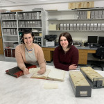 Helen Werner (left) and Haley Michael '19 (right) review museum records for their NAGPRA work at the Logan Museum.