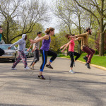 Ever creative, Dance Professor Gina Ta'i takes her class outdoors on a beautiful Spring day.