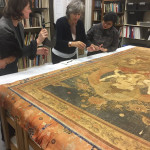 Wright Museum of Art Director Joy Beckman, ConservatorMarion Boyer, and students Amelia Nuzzo'20 and Sherry Dihn' 20 examine the Ushnishavidjaya thangka.