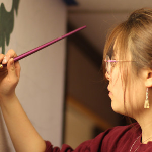 Hannah Kang'22 is one of four student artists commissioned to paint murals in common areas of Peet Hall. The project, created and managed by students, strengthens a sense of place and community in this popular residence hall.