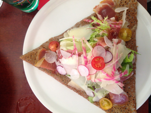 My favorite galette: prosciutto and melted camembert with a fresh vegetable salad on top.