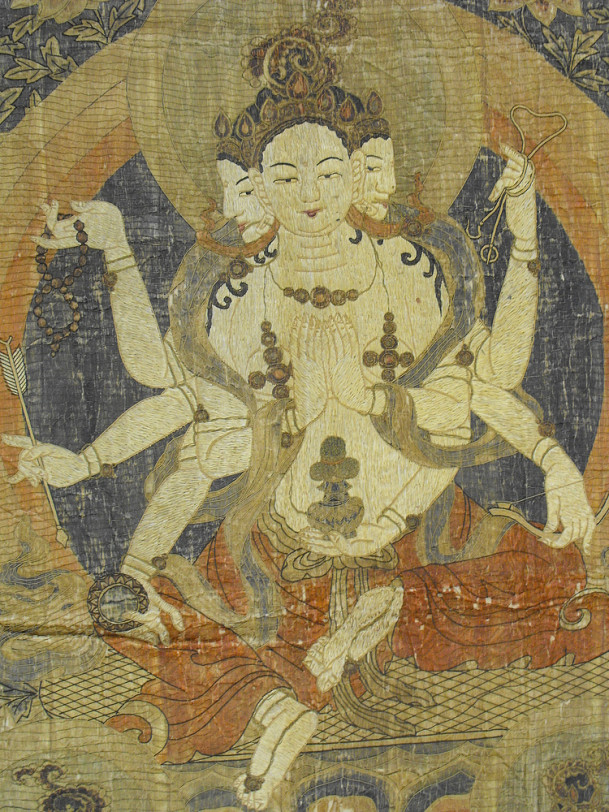 The Ushnishavidjaya thangka is a large silk embroidered Buddhist icon dating back to the 18th cen...