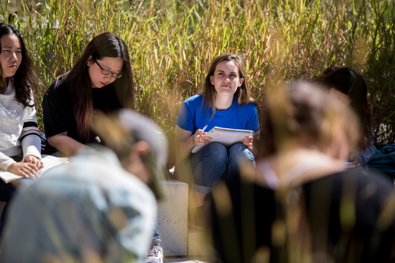 In spring and fall students attend a class outdoors in the garden near the Sanger Center for the ...
