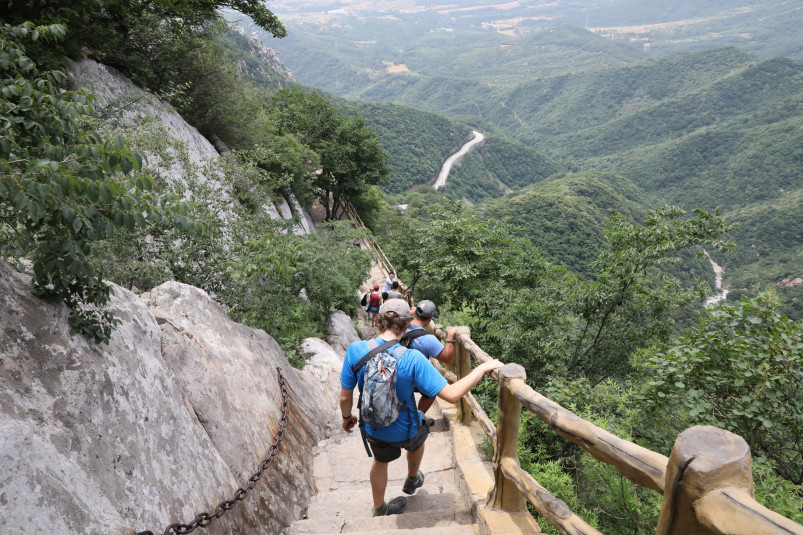 Beloit professors and students climb down a steep trail along the Yellow River in China during th...