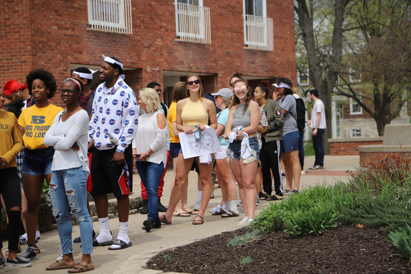 Students line up at food trucks during Spring Day