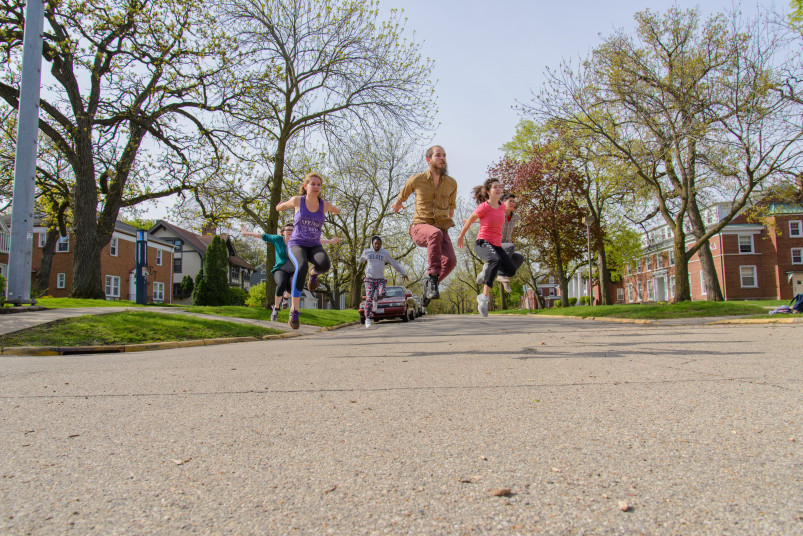 Dance students perform on College Street, by the residential halls.