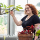 Rose Williams '21 spends some time among the plants in the campus greenhouse.