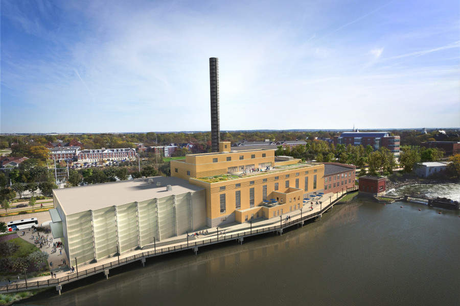 An aerial view of the Powerhouse seen from the river side, looking towards campus.