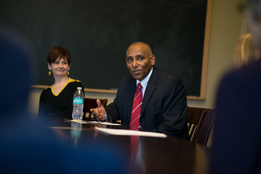 Weissberg Chair Eskinder Negash, Senior Vice President for Global Engagement for the United States Committee for Refugees and Immigrants (USCRI) converses with students in class.