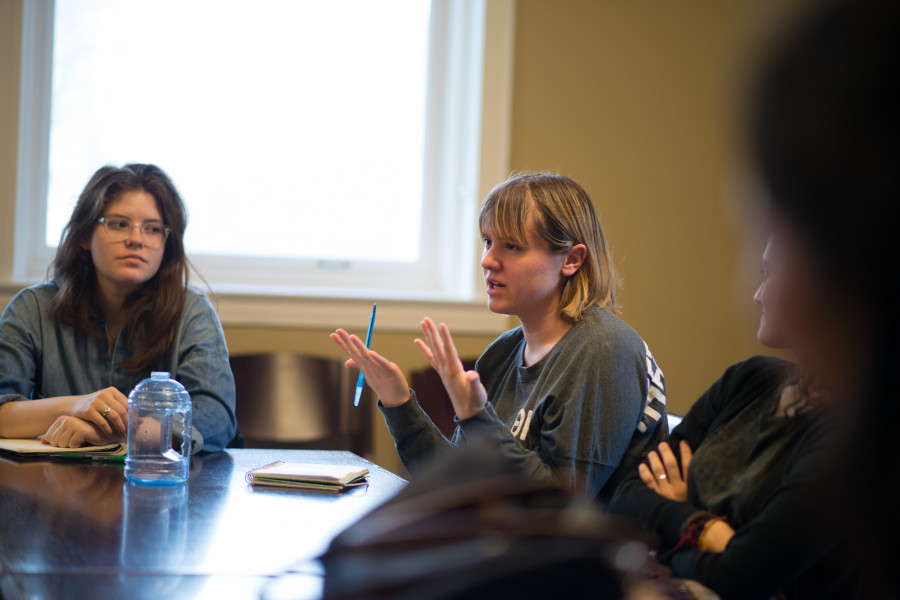 A student asks Weissberg Chair Eskinder Negash questions in class.
