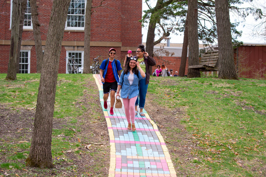 "Students walk along the ""Rainbow Path"" near the Wright Museum of Art."