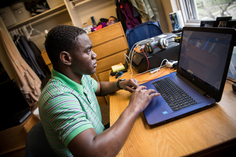 A Beloit student finds time to study in his dorm room.