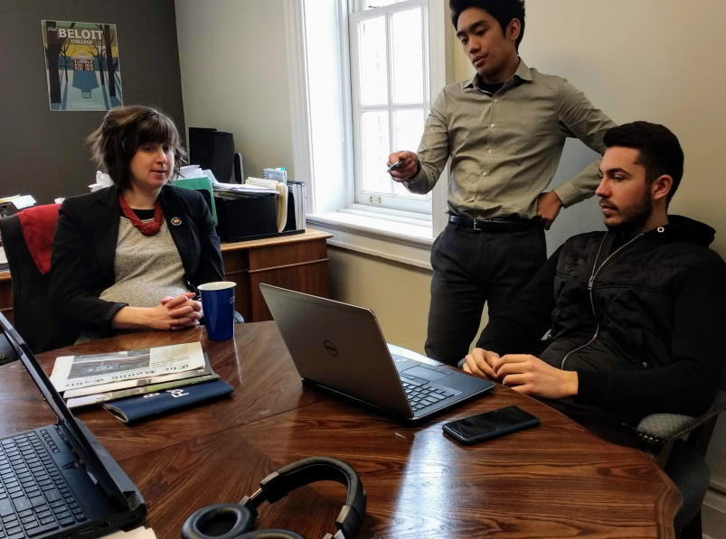 Ellie Anderbyrne'05, Caleb Nghe'20 and Gjergj Ndoci'20 discuss an analysis in the IRA...