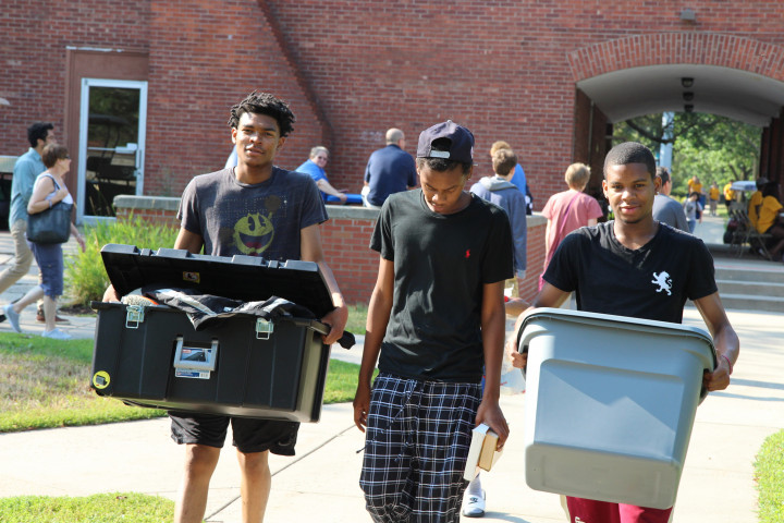 Three incoming freshmen students during move-in day.