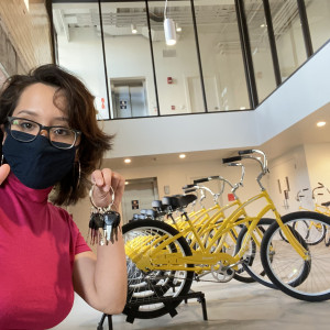 Daniela Aponte'23 poses with Sinnissippi Cruiser bikes at the Powerhouse.