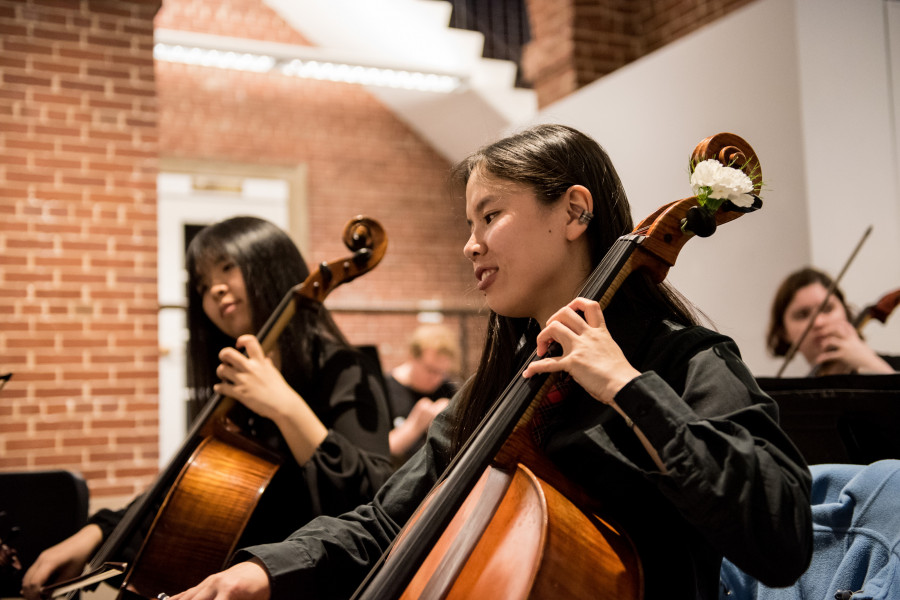 Members of a music department's strings group performs a concert in the Wright Museum's Courtyard Gallery.