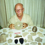 James Lockwood, Jr.'34 examining a collection of artifacts