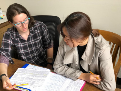 Lydia Wilson (on left) tutoring a student.