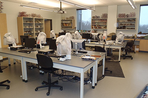 The mineralogy and petrology lab has petrographic microscopes and microscope cameras for identifying minerals.