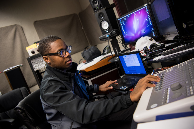 Student working with audio in the recording studio.