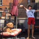 Gabe Gonzalez dancing for their dog Lucy on a balcony.