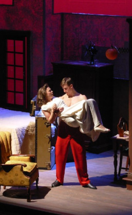 Stanley (Michael Kreiser) lifts Stella (Simone Stadler) in Streetcar Named Desire by Tennessee Wi...