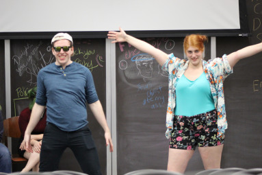 Julia Dirkes-Jacks and Joshua Block hold for applause during an improv show by Adult Themes, a st...