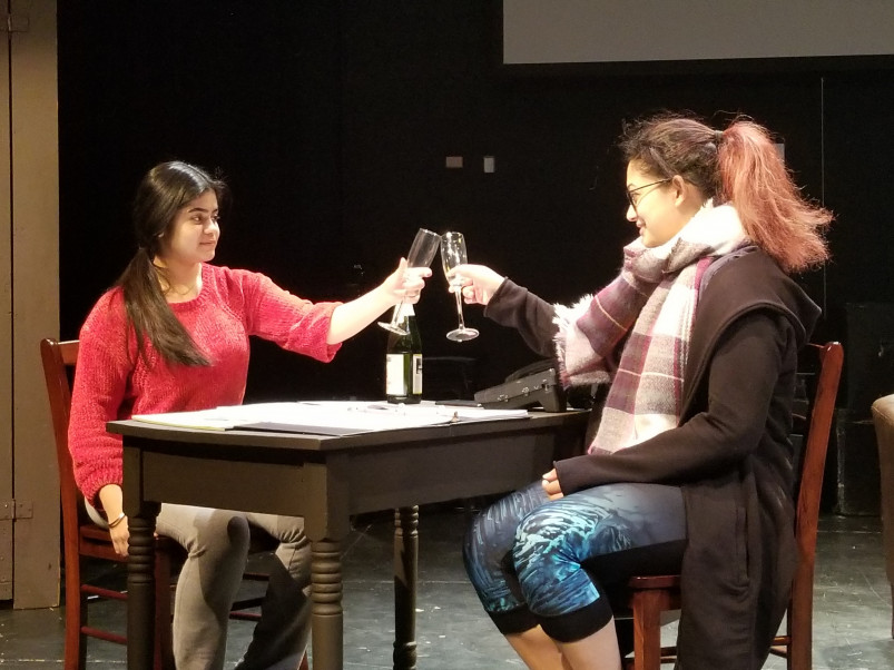Actors toast in The Who and The What by Ayad Aktar and produced by BITE.