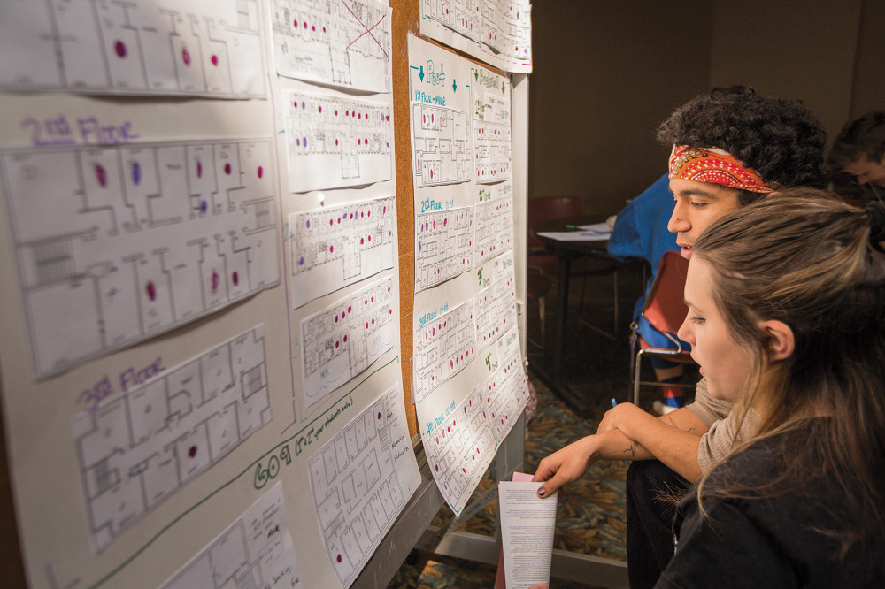 Students weigh their room options from floor plans posted in Pearsons Hall during the room lotter...