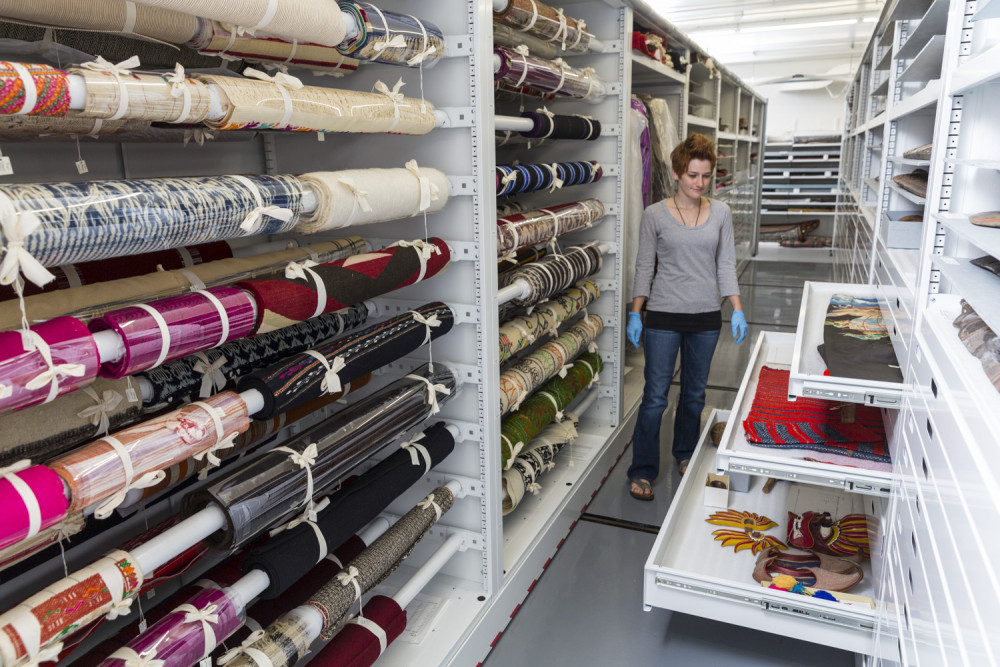 Assistant Curator Krista Barry?15 in the textile storage area of the Logan Museum of Anthropology...