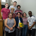 Syliva Lopez, professor of Spanish, is surrounded by her students as she received the Underkofler...