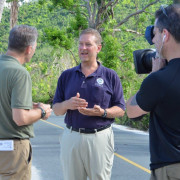 Patrick Cornbill talks to media after hurricanes hit the Virgin Islands in 2017.