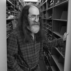 Fred Burwell'86 standing in the midst of the Beloit College archives.